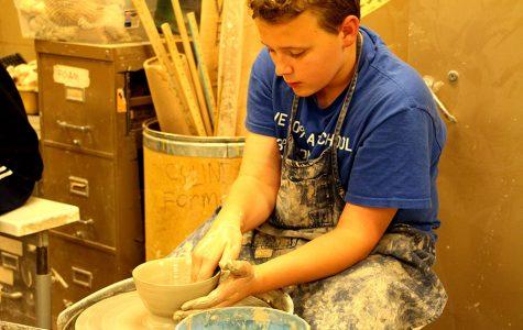 Loren Morain works at the wheel to help Powderhorn Empty Bowls