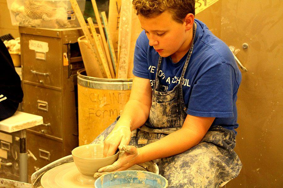 Loren Morain works at the wheel to help Powderhorn Empty Bowls