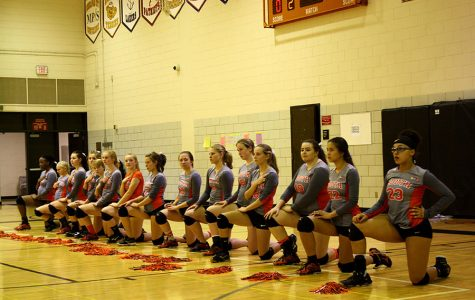 South High Varsity Volleyball taking a knee at their game against Edison in solidarity with the Black Lives Matter movement. They first took a knee at their game against Washburn on September 15 and have done it at every game since.