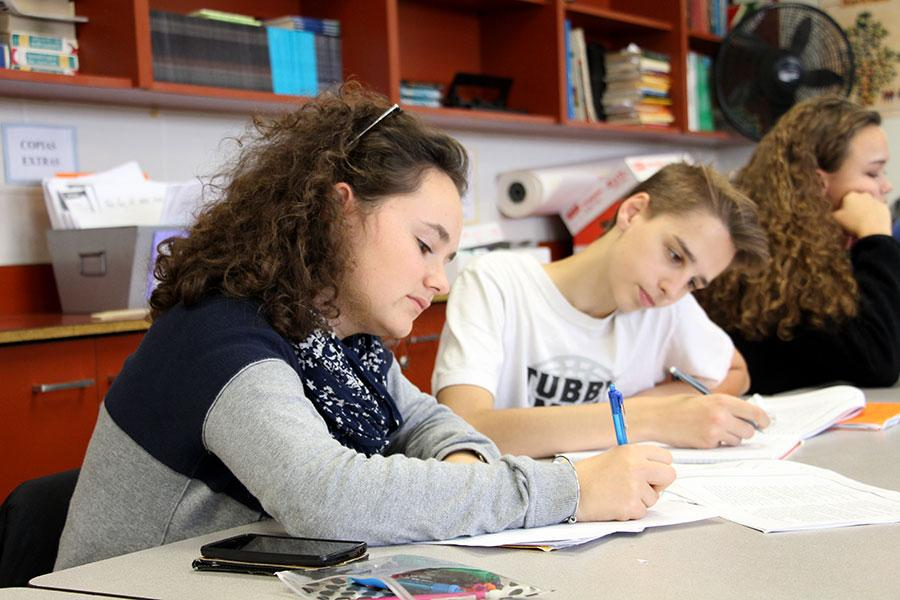 The exchange student, Anna Bichon from France, during her Spanish lesson, concentrated with her homework, beside an American classmate of South High.