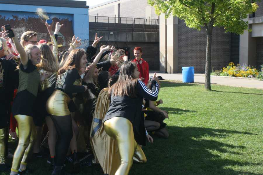 South seniors come together to take pictures of their black and gold attire. Although the name was changed to Neon Day due to seniors hazing freshmen, South students have continued getting dressed up as their grade's color for the day.