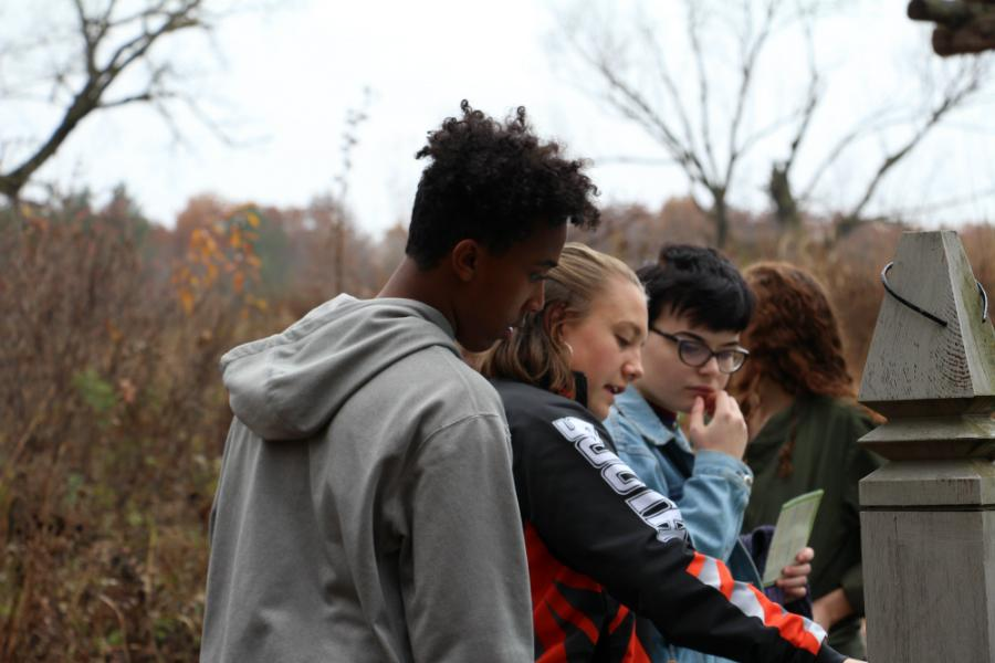 Green Tigers looking at a map to find their way back to the car. The field trip to the Arboretum on October 27th was organized by and for Green Tigers, South High's environmental group.  Photo: Luca Raffo-Simoes