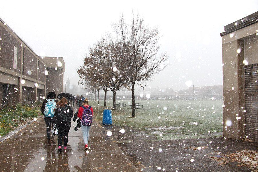 """As the first snow of the season fell, many students shivered and pulled their hoods up tight. Others though were taking in the beauty of the flurries.  """"It turns Minnesota into a whole new place and you feel like you're in a snow globe. I love it,"""" said senior Molly DeVore."""