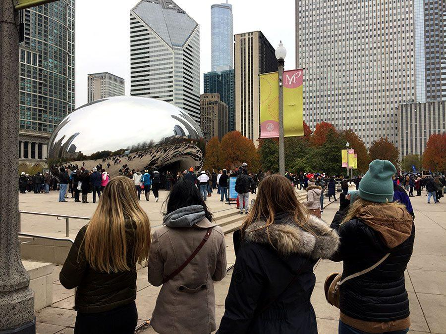 A group of students looking at the Cloud Gate sculpture during some free time. Photo: Eli Shimanski