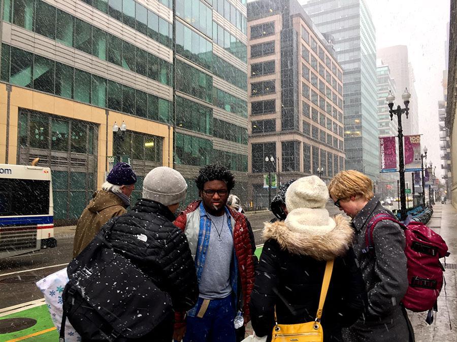 As the group headed back to their bus, light snow began falling on them. Photo: Eli Shimanski