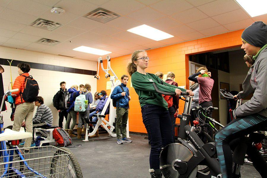 Nordic skiers relax and get ready for an hour long practice at Theodore Wirth Park. The Nordic team practices everyday after school until a little past five, depending on weather the team is doing strength workouts, waxing their skis, or getting out to the park to ski. Photo: Luciana Rian-Senna