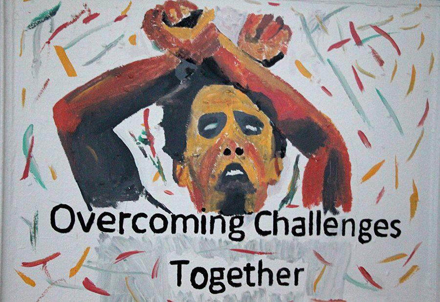A+painting+of+Silver+Olympian+Feyisa+Lelisa+crossing+the+finish+line+at+Rio+Olympics+showing+the+symbol+with+crossed+arms.It%E2%80%99s+symbolizes+the+oppression+of+the+Oromo+people+showing+how+their+hands+are+tied+without+the+need+of+handcuffs.+This+courageous+act+done+by+Lelisa+has+brought+attention+to+the+protest+that+is+going+on+in+Ethiopia+by+the+Oromo+and+Amhara+people.+This+painting+was+by+the+Oromo+Student+Union+at+the+University+of+Minnesota+Twin+Cities+Washington+Avenue+Bridge.+Photo%3A+Asanti+Bekele%0A%0A