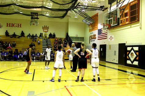 Pictured above junior Morgan Hill, along with senior Rose Lutz, participate in a free throw against Minneapolis North Community school. The south women