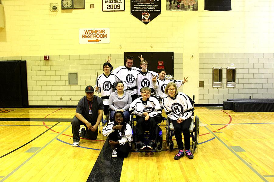 Pictured above: South's adapted floor hockey team poses for a team photo after their massive win against South Suburban.  The team looks forward to making it to state this year which will take place on March 17th and 18th.  Seniors on the team include Hanna Bolstrom, Mark Runquist, Mohammed Mohammed, and Noah Novacek. Photo: Henry Holcomb