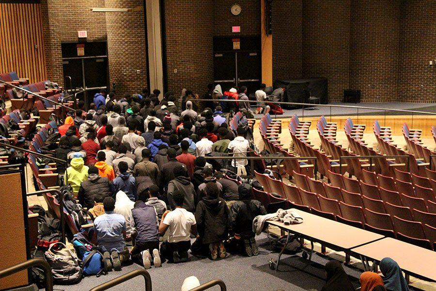 A group of Muslim students praying in the auditorium at South. These prayers are organized by Muslim Students Association (MSA) and led by South students.