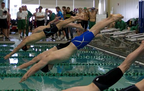 """Pictured above. Dutch Franko-Dynes is in the blue. He is diving into the water at a race, one of his teammates said """"He encourages the team and likes to have fun on the team as well.""""  Photo courtesy of Jennifer Franko"""