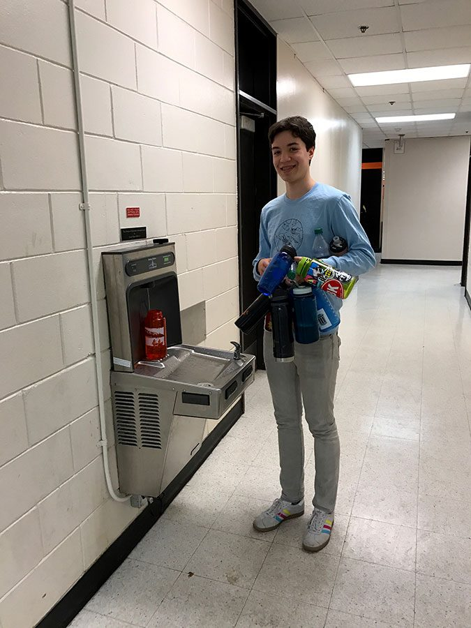 Junior Avery Hultgren makes the daily water run to the Station of Hydration for his classmates. While putting in these stations, some of the contaminating fixtures, aka the old water fountains, were removed. Because the Green Tigers made it possible for South to get three of these filtration stations, the rist of lead being in the water is lower than at the other, older, drinking fountains around the school. Photo courtesy of Aria Kressel.