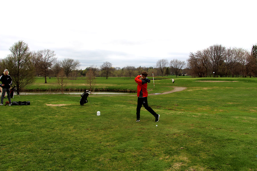 Pictured above Django Lebeau prepares his first swing of the second hole in the South High golf team's game against Roosevelt on the 18th. This is the team's first game of the season. Photo: Oliver Hall