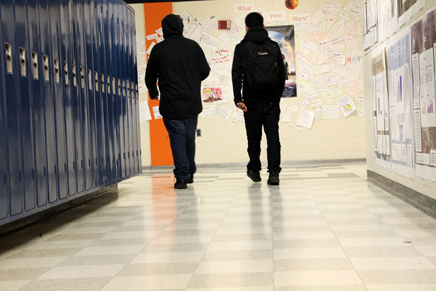 Two students wander the halls together instead of sitting in class. These students are just two of the many students that skip class.