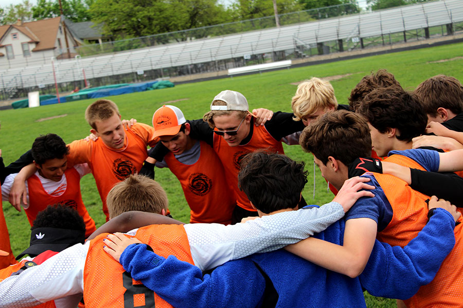 Pictured above the JV Frisbee team huddles before playing a game against Southwest. Huddling is one  way coaches motivate their players, and offer criticism and tips. Freshman and Ultimate Frisbee player, Christian-Seth Nguyen, often prepares for his games by,