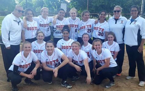 "Pictured above the softball team poses at Highland. The softball team is not only amazing on the field, but it is a tight knit community as well. ""You can just hang out with your friends everyday and do something you love,"" Sophomore and softball player Claire Bentfield said. Photo courtesy: Jessica Dynneson"