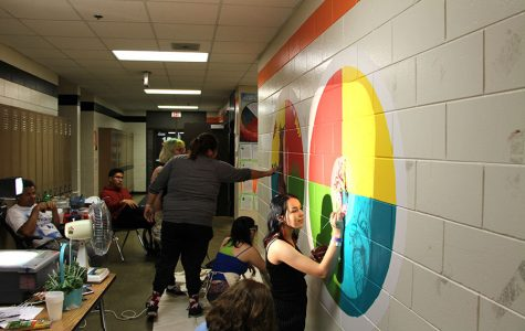 Pictured above students participate in making a mural in the hallway near the All Nations classrooms. Photo: Henry Holcomb