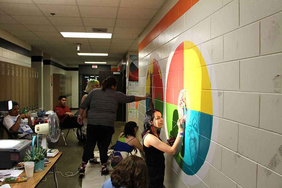 Pictured+above+students+participate+in+making+a+mural+in+the+hallway+near+the+All+Nations+classrooms.+Photo%3A+Henry+Holcomb+