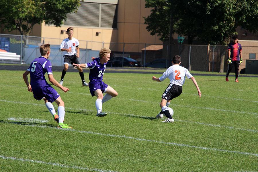Junior Miguel Brandao tries to control the ball. (Men's Junior Varsity)