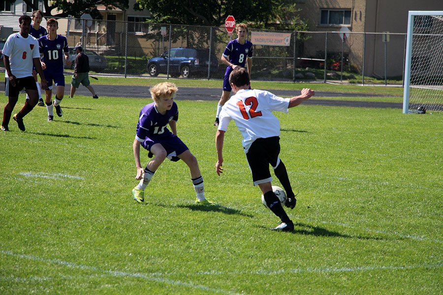 Sophomore Josiah Misselt runs down the field while trying to pass a Southwest defender. (Mens Junior Varsity)
