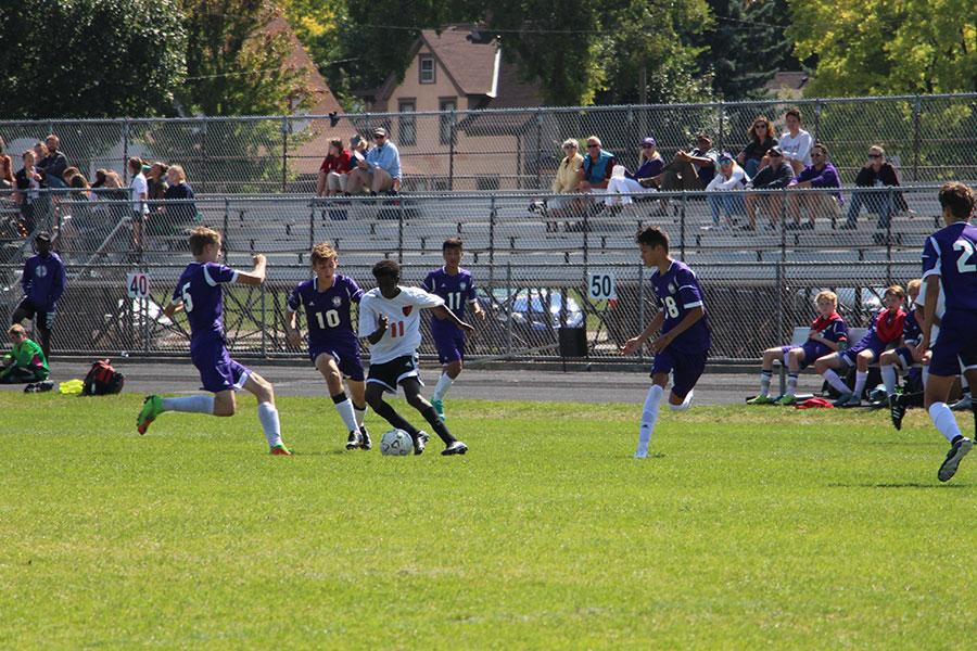 Abdi Farah tries to make his way around some Southwest defenders. (Mens Junior Varsity)