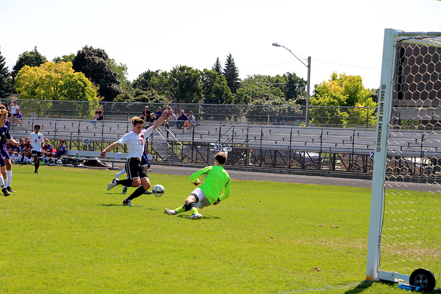 Sophomore Jude Nair winds up to put a shot on net. (Mens Junior Varsity)