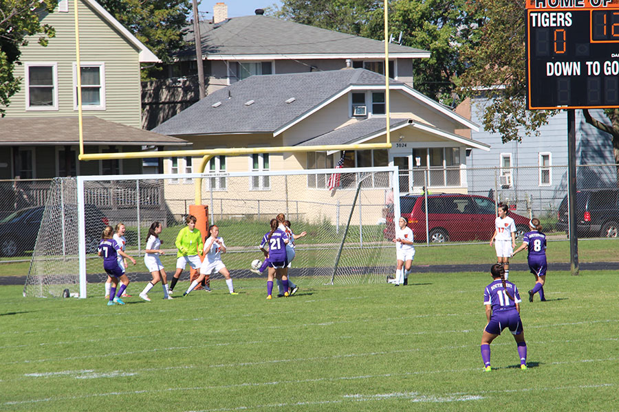 A group of South players defending the goal after Southwest has shot the ball. (Women's Junior Varsity)