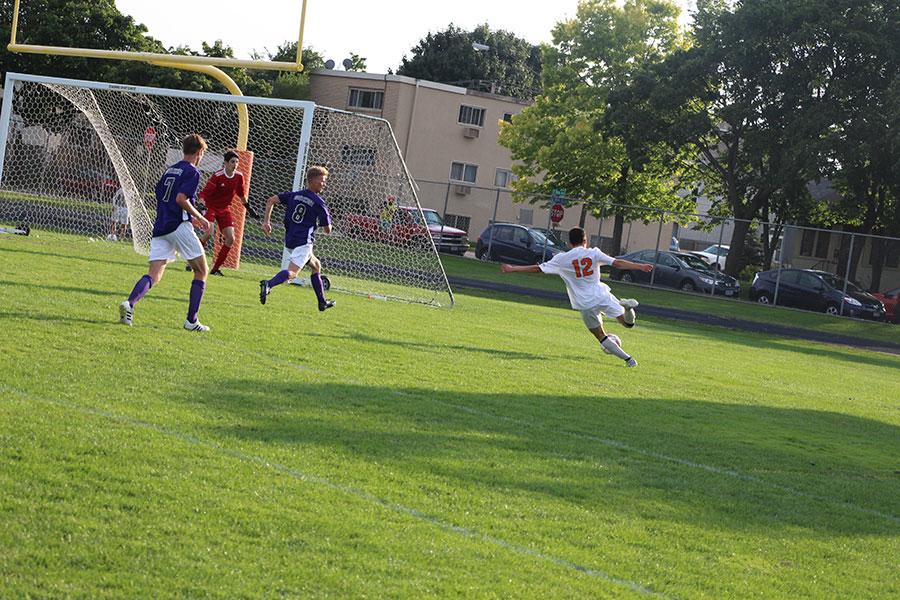 Fidel Diaz putting a shot on goal. (Mens Varsity)