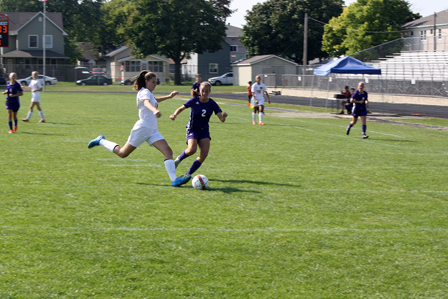 Sophomore Maisy Johnson trying to get the ball away from a Southwest player. (Women's Varsity)