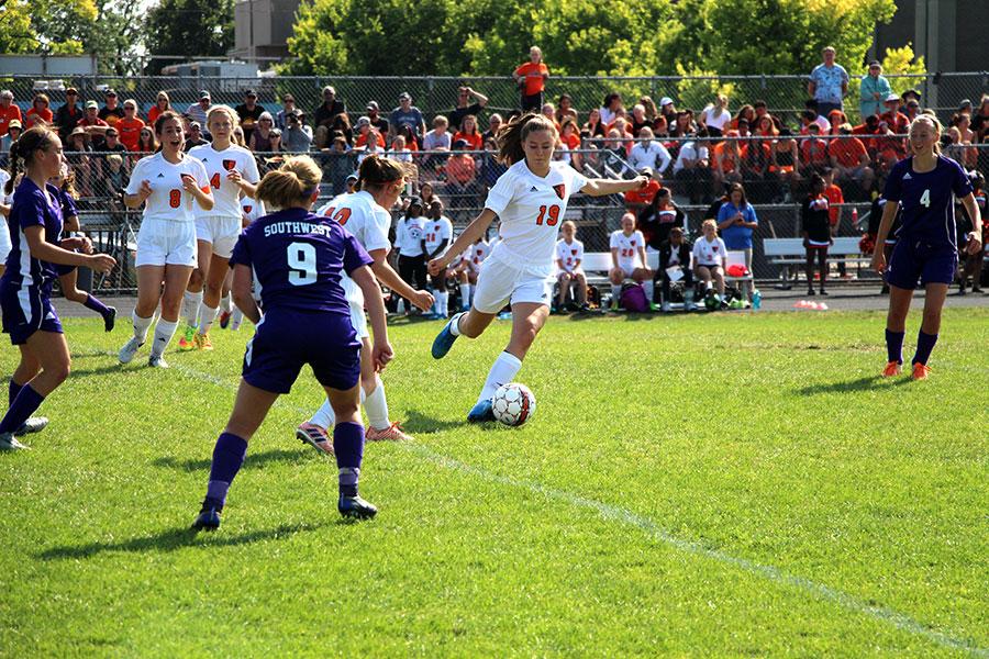 Sophomore Maisy Johnson  kicking the ball up field towards the Southwest goal. (Womens Varsity)