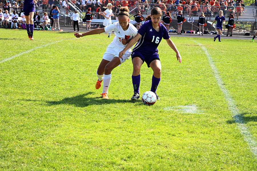 Sophomore Claire Jensen trying to get the ball away from a Southwest player. (Womens Varsity)