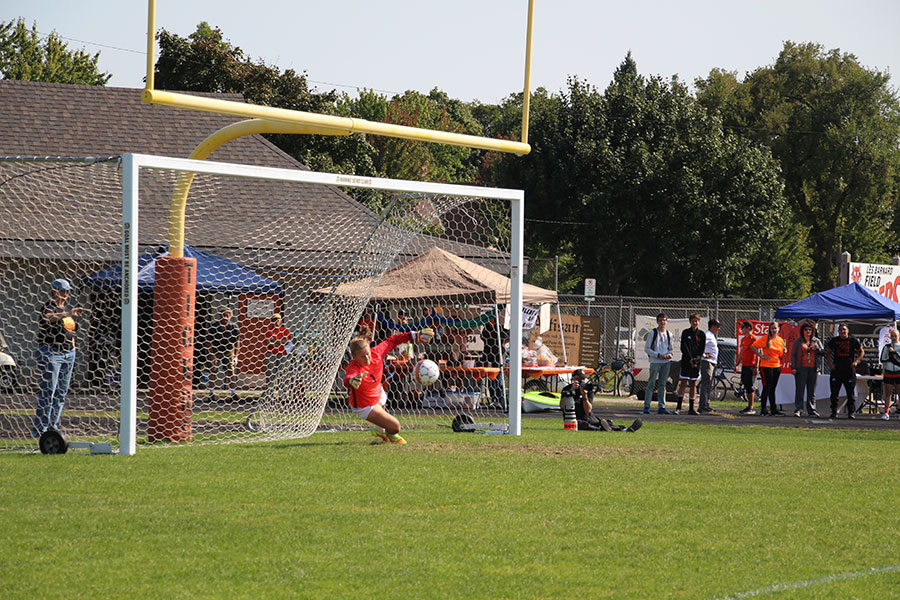 Freshmen Chloe Olson diving in front of the ball to try to stop the ball from going in the net.