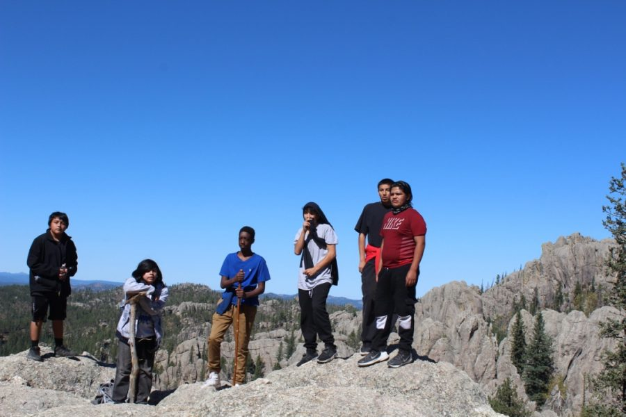 Students (far right) Minnewa Burris, Clifton Hallow, Joe Sciece, Destin Capers, Daymin Perze-LaRoque, Tyler Bonnete (far left) stand on an outlook of the