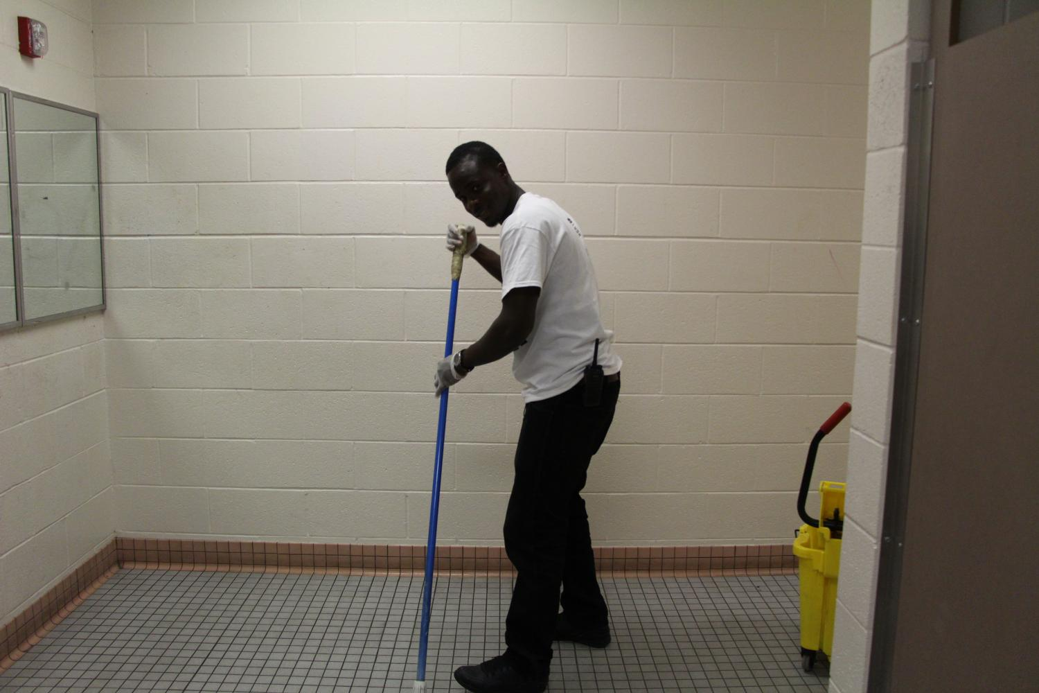 Pictured above Amuchin Dann is cleaning the third floor women's bathroom about an hour and a half after school. He is a night shift custodian who has worked at South for a few months. He has been treated well by students and staff and enjoys it here. Photo: Oliver Hall