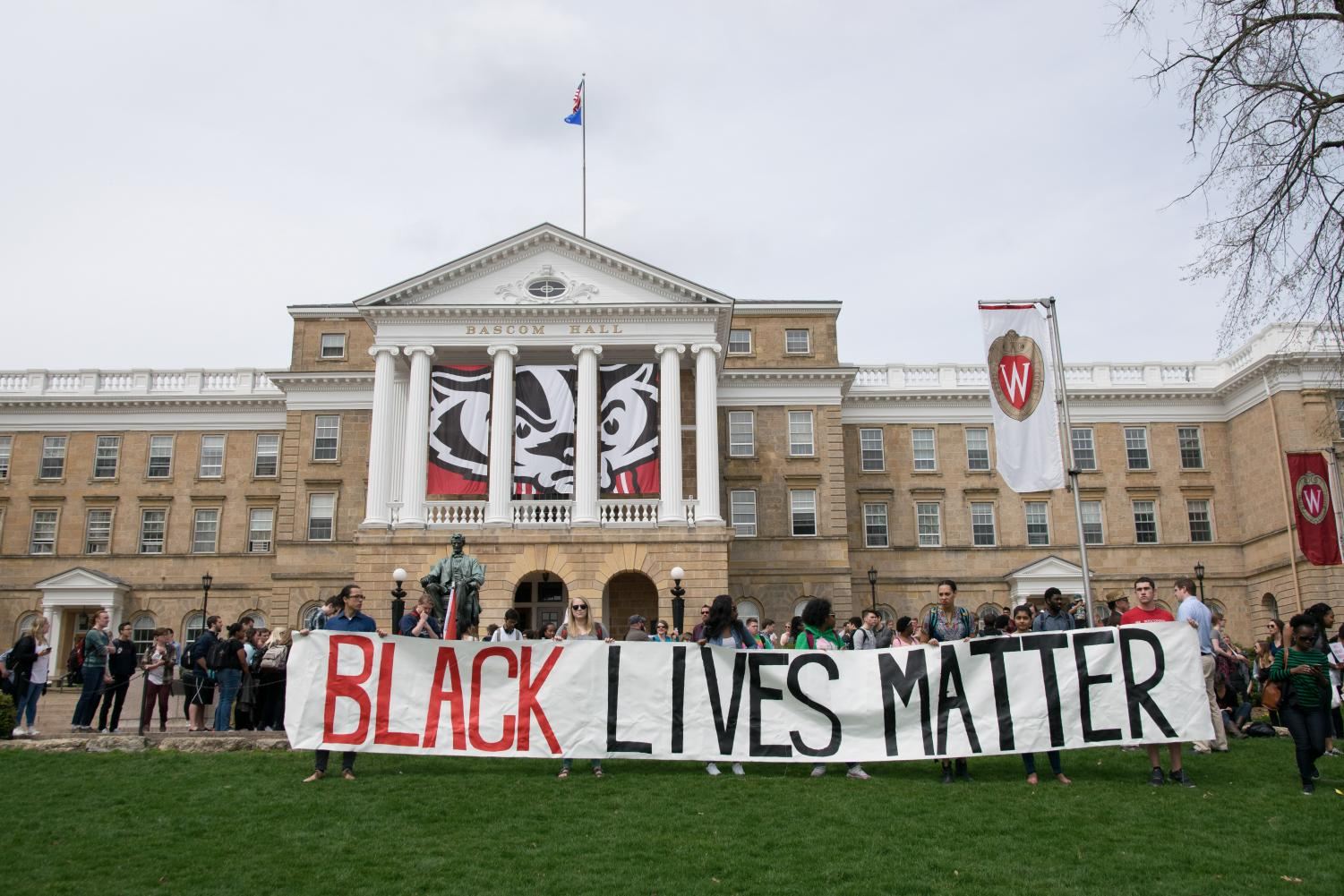 Pictured above are University of Wisconsin Madison students on April 21st, 2016 protesting the arrest of fellow student Denzel McDonald. With the passing of the Wisconsin Senate's 229 Bill student protest rights have been under question.