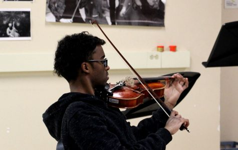 """Senior Abdirahman Katun plays the viola in Beginning Strings. One of a few entry level music classes, Beginning Strings allows students who have never played before to learn a string instrument. """"We're lucky here at South because our administration has put stringed instruments into the hands of the students who want to learn them, they put the money out for it and so this is why we can do it,"""" said Lorie Hippen, the South orchestra instructor."""