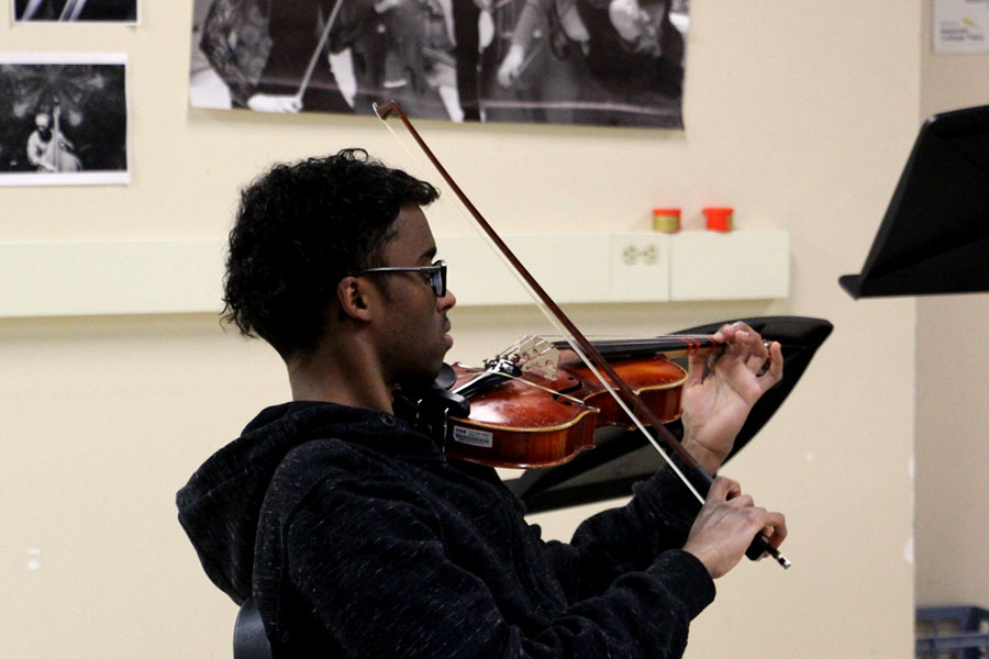 "Senior Abdirahman Katun plays the viola in Beginning Strings. One of a few entry level music classes, Beginning Strings allows students who have never played before to learn a string instrument. ""We're lucky here at South because our administration has put stringed instruments into the hands of the students who want to learn them, they put the money out for it and so this is why we can do it,"" said Lorie Hippen, the South orchestra instructor."