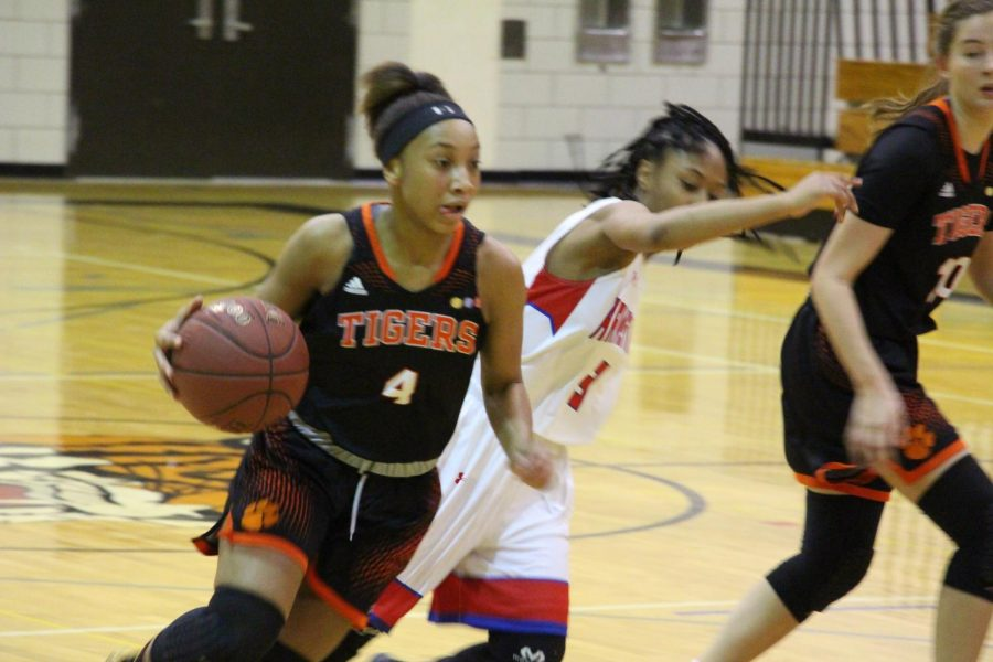 Freshmen Jade Hill makes her way around an Armstrong defender on her way to scaring a lay-up