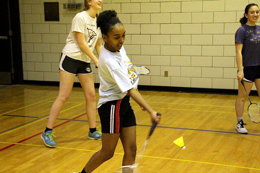 """Senior Derartu Ansha warms up with a few shots at badminton practice. Ansha has been playing badminton for four years, and is open to the idea of the sport not being exclusively for women, """"I think it would be fun to play badminton with all genders because it's just a fun sport so why not bring them all in?"""" Photo: Izzy Willette"""
