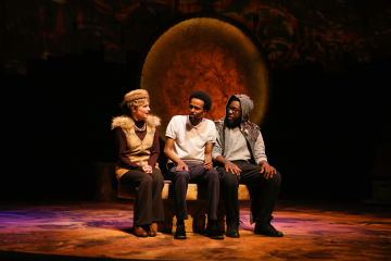 Actor Mohamed Ahmed portrays Ahmed Yusuf as a struggling college student. On either side of him (from left to right) are actors Tracey Maloney and Mikell Sapp playing Camel and Owl, characters that represent Ahmed's conscience and help him through difficult times