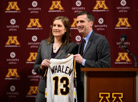 Caption: Lindsey Whalen with University of Minnesota athletic director Mark Coyle after being introduced as the new women's basketball coach. Whalen will be coaching the team she played for when she was a student at the University of Minnesota. Photo courtesy of Star Tribune