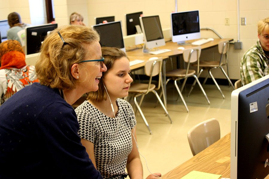 "French teacher Melissa Davis helps sophomore Gillian Rath with a computer test. ""I have a hard time leaving because teaching has been my life... but I'm also excited to go on and do other things too,"" Davis explained. Photo: Izzy Willette"
