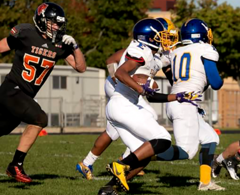 Pictured above, senior Michael Warner (57) playing defense at South