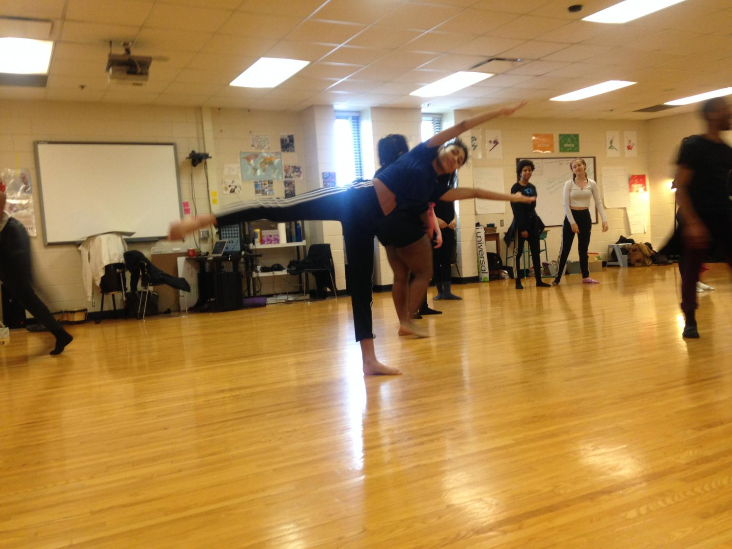 South High students warming up in the classroom. Dance can be used to express and articulate issues as art and exercise. This art form can be seen all throughout South, including school dances and the May Day parade. Haakon Anderson, a sophomore and member of Dance Company I, explained,