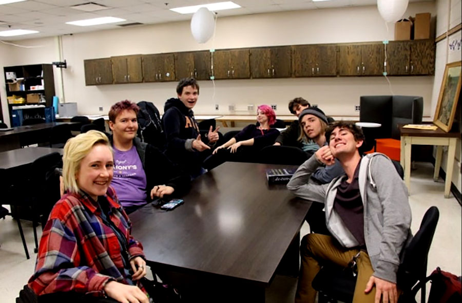 """On October 4th, The One Act Club's first meeting was held in the Writer's Room. On the left is Iris Eichinger who has this to say, """"[One acts are] one of the few writing things you can do … if you're still an underclassman."""" Pictured above, Iris Eichinger, Kieran Panning-Miller, Banyan Bendzick, Matthew Baltzer Lavoto"""