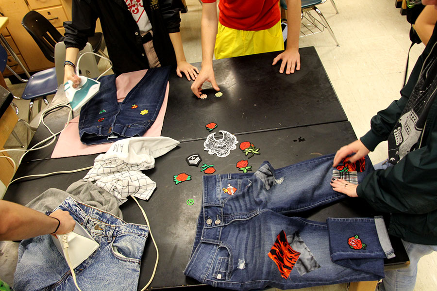 """The new South Fashion Club is doing a DIY project on denim. The club sews patches on clothing. """"Fashion is my way of expressing myself because I've never gotten into art or anything like that so, fashion is my way of expressing my personality through my outfits,"""" said junior club Founder, Sonya Maier. Photo: Suad Adam"""