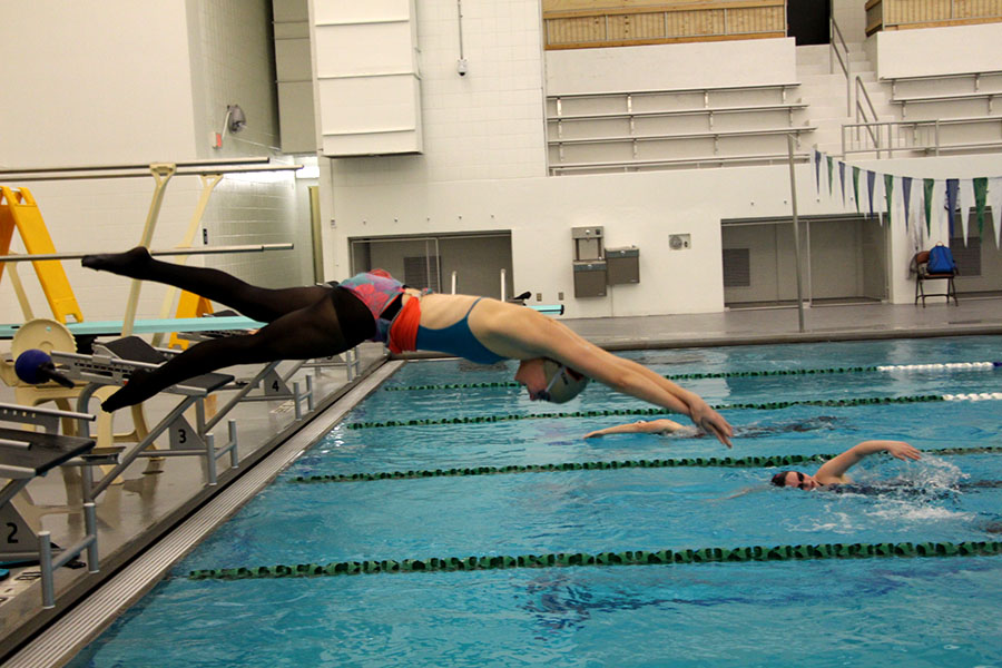 "Washburn Swimmer Eleanor Dolan dives into the new pool at Phillips Community Center. Senior swimmer and captain Sophie Hansen feels ""it has been very awesome to have our own swim pool""."