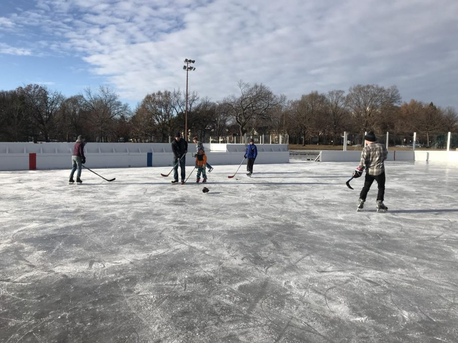 Neighbors gather for a game of pickup hockey at Matthews Park.