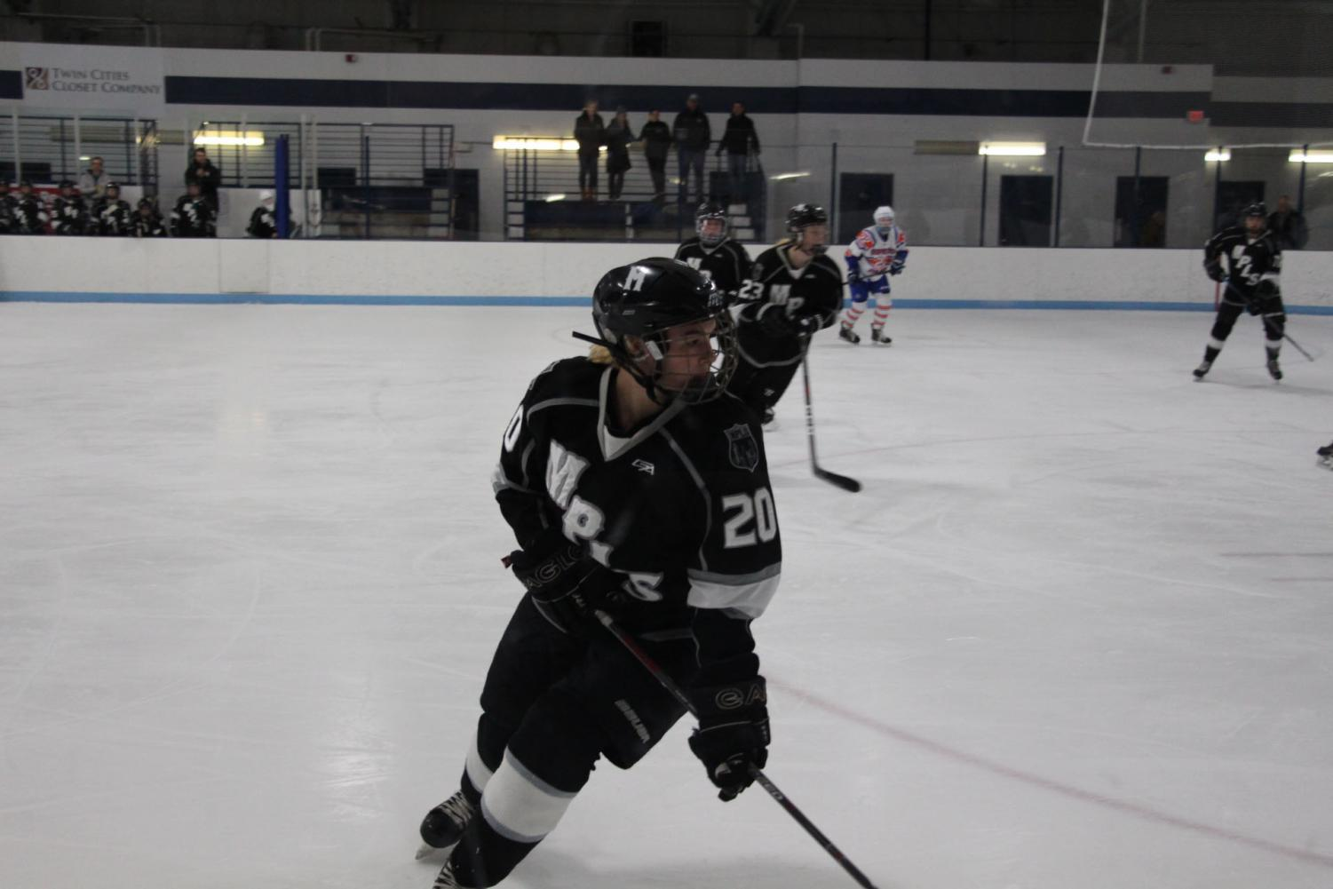 "Senior Julia Offerdal on the varsity hockey team for Minneapolis playing against Saint Louis Park. Many things have changed for women in hockey.  ""The girls that did play at a high level played with the boys,"" said Sarma Ozmen, the Minneapolis Women's Hockey head coach."