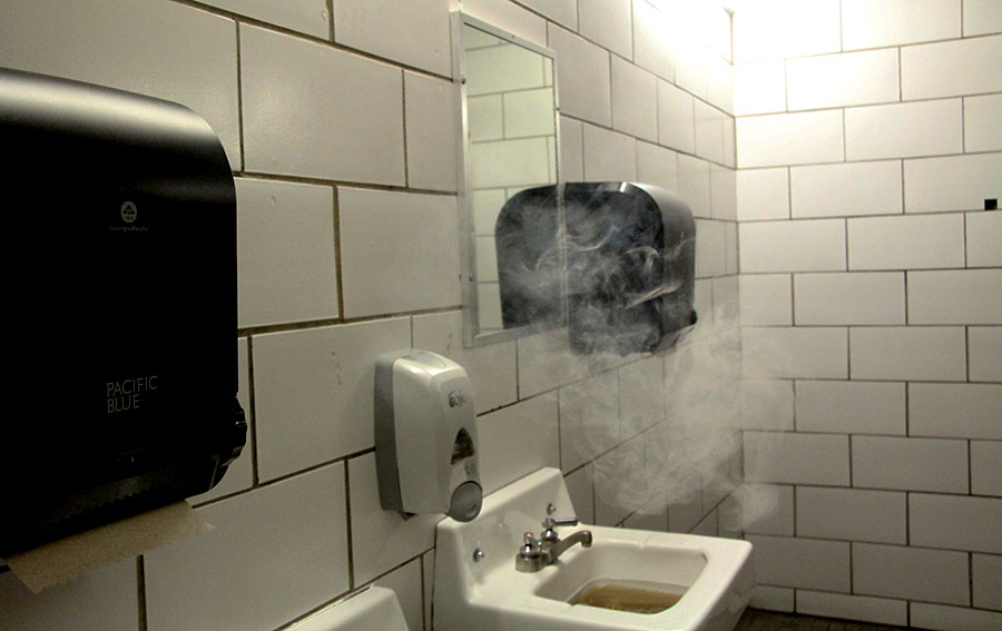 "Above you see smoke from students vaping and a clogged sink in the gender neutral bathroom, these problems often occur and result in the bathroom ""having to close which means that several students have nowhere to go to the bathroom,"" said freshman Max McKinnel."